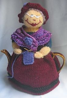 Cute knitting granny tea cosy