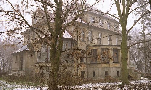 Abandoned Mansion, Ostrowo, Poland.  Ostrowo is a village in Poland, and home to the grand house above which looks to be in reasonably good condition.  Though clearly once the home of an affluent family, perhaps this abandoned house is not quite ready to give up its secrets yet – except perhaps to urban explorers.