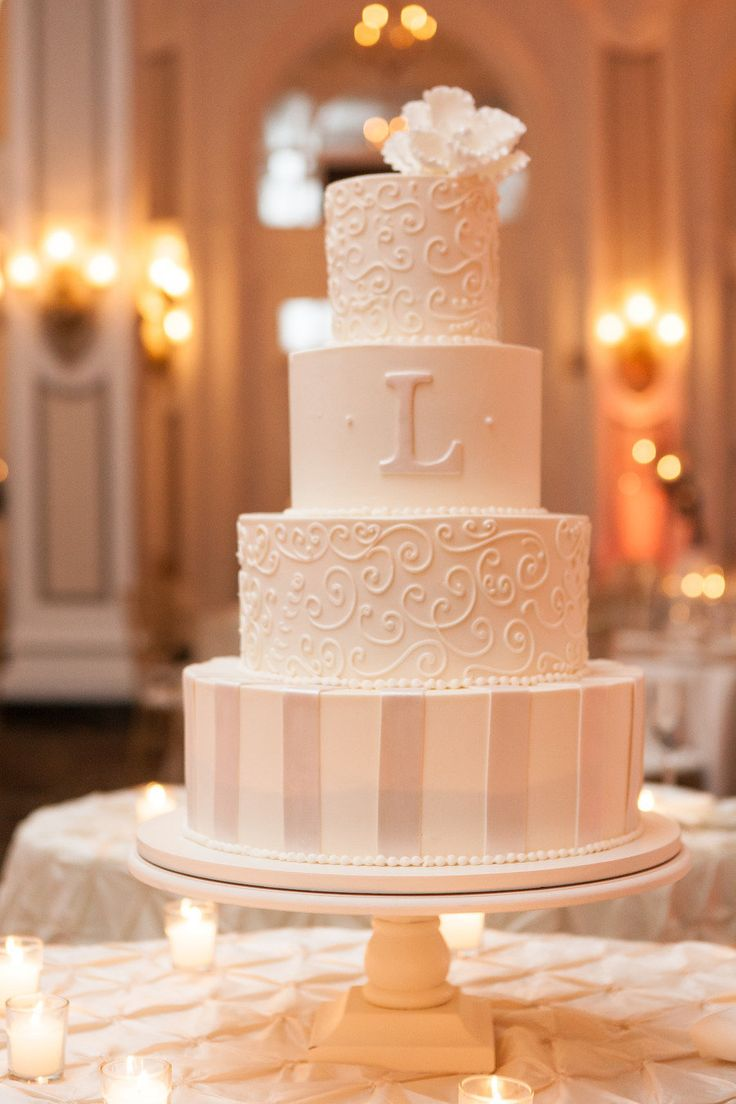 Patterned ivory wedding cake with monogram - layered tiered wedding cakes  http://www.pinterest.com/JessicaMpins/