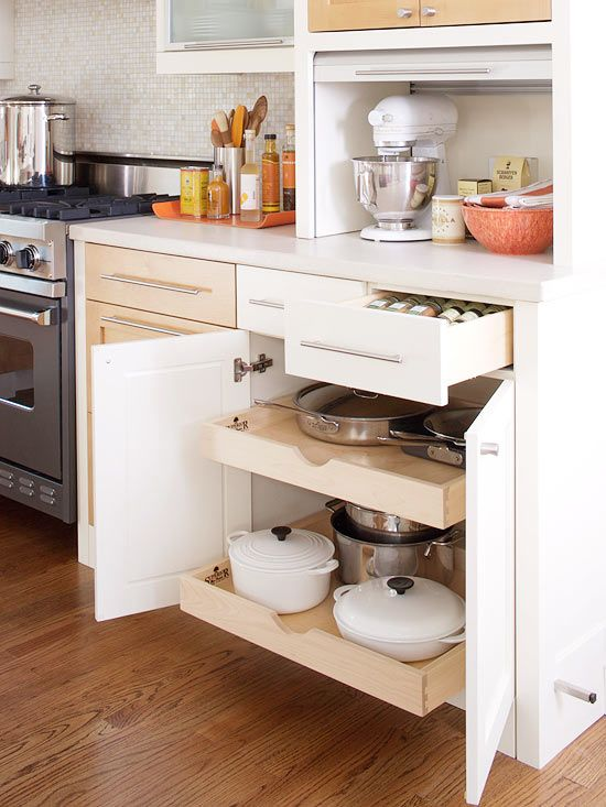 Pullout shelves maximize every inch of cabinet space and ensure that no pots or pans get lost at the back of the cabinet: http://www.bhg.com/kitchen/styles/modern/contemporary-traditional-kitchen/?socsrc=bhgpin052614spacesavingshelves&page=4