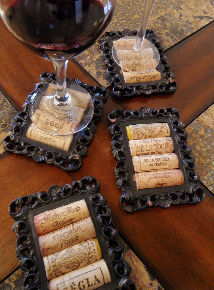 "OK, I am doing this for Christmas gifts this year..... DIY - Coasters from wine corks and old picture frames... This is a set of 4 coasters, 4 1/2"" x 3 1/2"" including the black, ceramic frame and 1/2"" thick. The cork area is 3"" x 2"" and the corks are about 1 cm higher than the frame itself. <3 Love this. Gonna use this for my home ideas!"