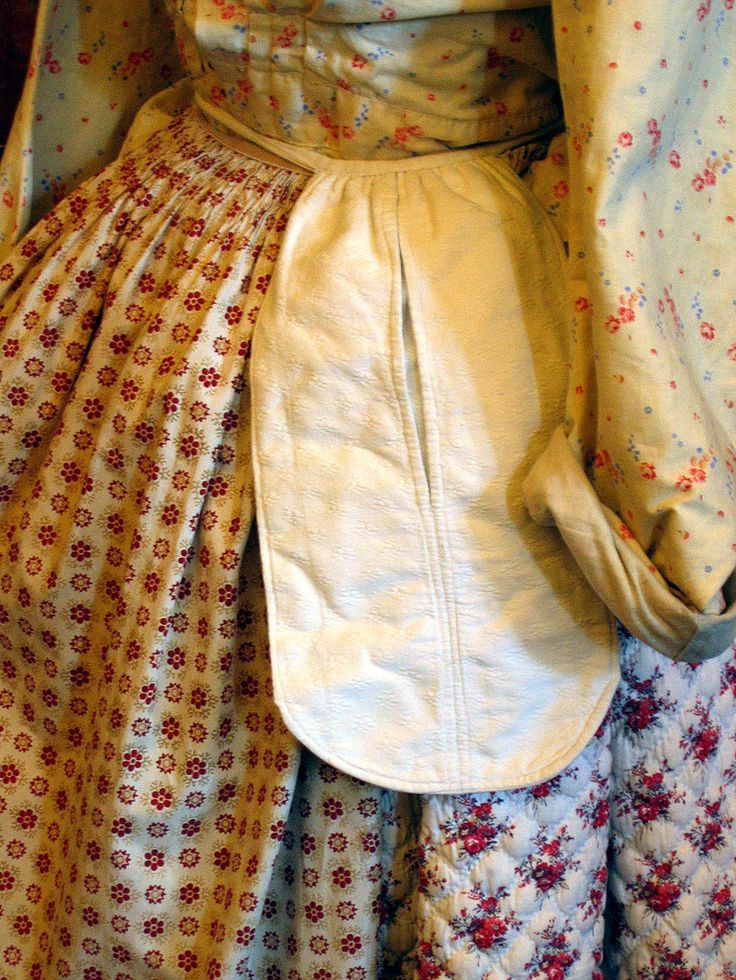 French Provencal early nineteen century traditional day wear costume. Varied small printed fabrics.  Designs mainly of miniature bouquets, floral and paisleys.  Quilted cotton, layers upon layers. Pocket purse attached at waist.