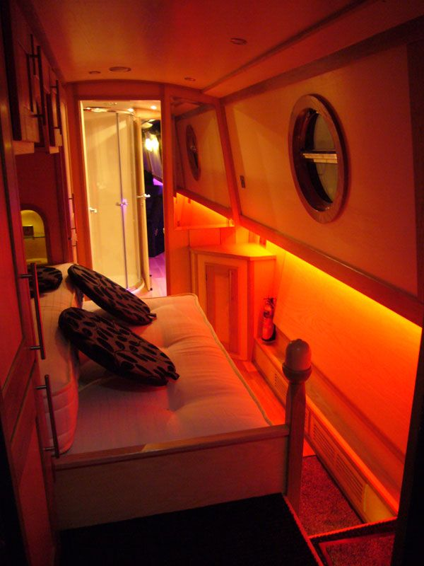 Super modern lighting in narrowboat interior bedroom