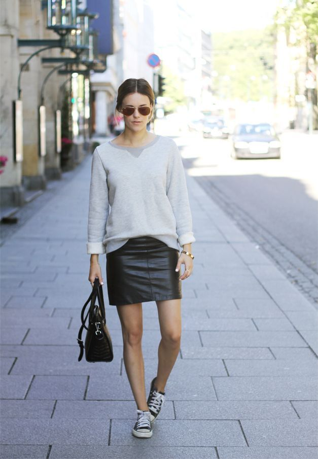 Pair a grey crew-neck jumper with a black leather mini skirt for a casual level of dress. For a more relaxed take, throw in a pair of black and white low top sneakers. Shop this look for $88: http://lookastic.com/women/looks/sunglasses-crew-neck-sweater-mini-skirt-tote-bag-low-top-sneakers/4205 — Dark Brown Sunglasses — Grey Crew-neck Sweater — Black Leather Mini Skirt — Black Leather Tote Bag — Black and White Low Top Sneakers