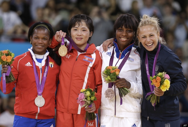 Silver medalist Acosta Bermoy, of Cuba, from left, gold medalist An Kum Ae, of North Korea and bronze medalists Priscilla Gneto, of France and Rosalba Forciniti, of Italy, share the podium after the women's 52-kg judo competition at the 2012 Summer Olympics, Sunday, July 29, 2012, in London.