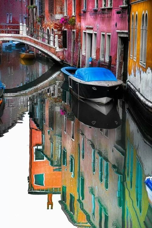 Stunning photograph from Venice- the houses, and their reflections, are so colourful!