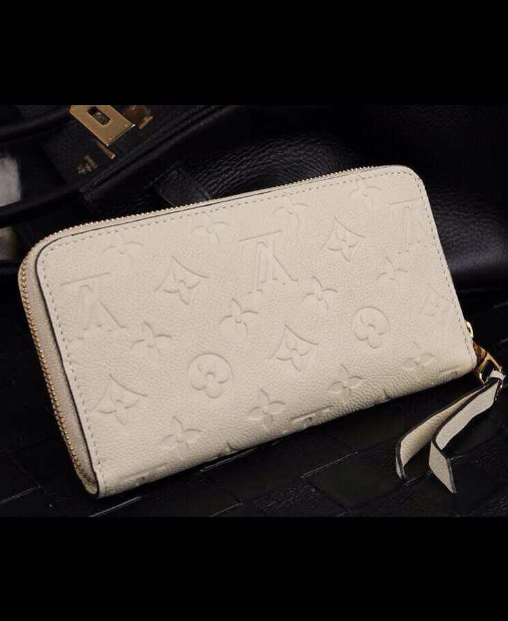 Louis Vuitton Monogram Empreinte Zippy Wallet Neige sale at USD 135.  Free international shipping. Check it out on http://www.dfodiscountbags.ch/louis-vuitton-monogram-empreinte-zippy-wallet-neige-m60546