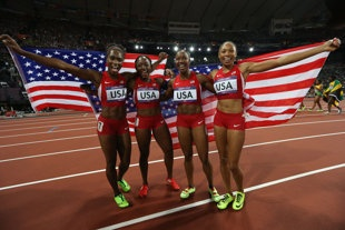 Carmelita Jeter, Bianca Knight, Allyson Felix, and Tianna Madison celebrate after winning the Womens 4 x 100m Relay Final (Getty Images)