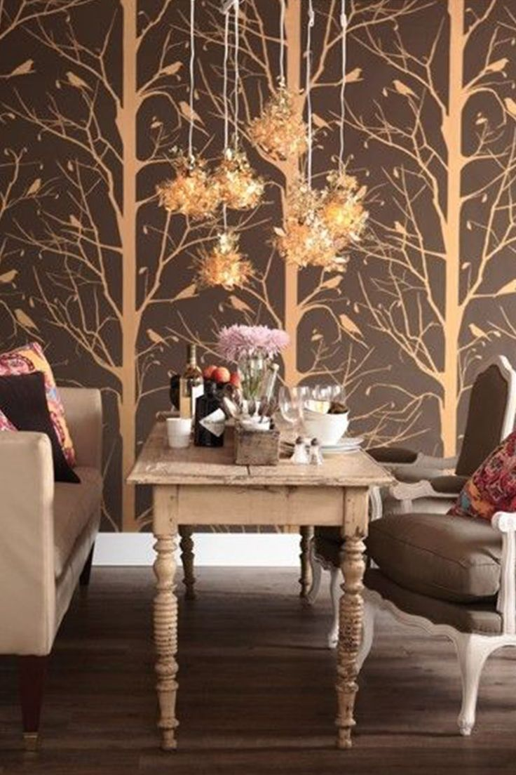 Use large-scale wallpaper in a small room for big impact. The gold bird and  tree motif offers a whimsical touch in this living room and ...