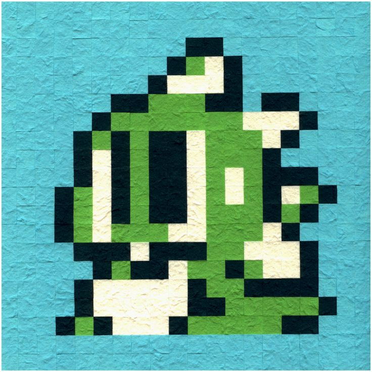 "bubble bobble paper cut pixel artwork. cuts are 1/2 inch squares of handmade Thailand paper glue sticked onto a 10"" inch paper board. not sure if or when i will be making more bubble bobble paper cut art, but hopefully i do because i purchased a bunch of this paper and would prefer to do something with it. : )  original sprite art from bubble bobble 2 for the nintendo entertainment system, and is the icon for the number of lives left at the top of the hud."
