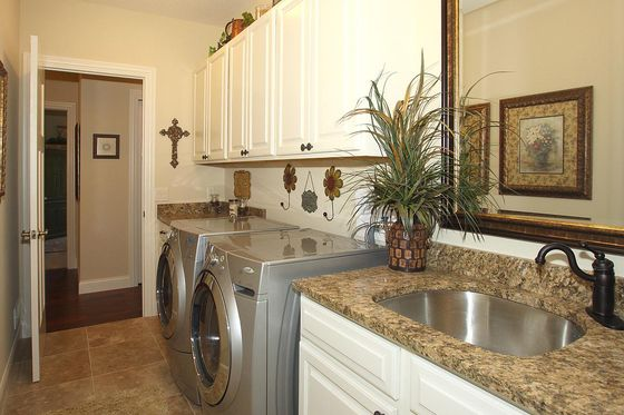 Nicely decorated Laundry Room w neutral color scheme
