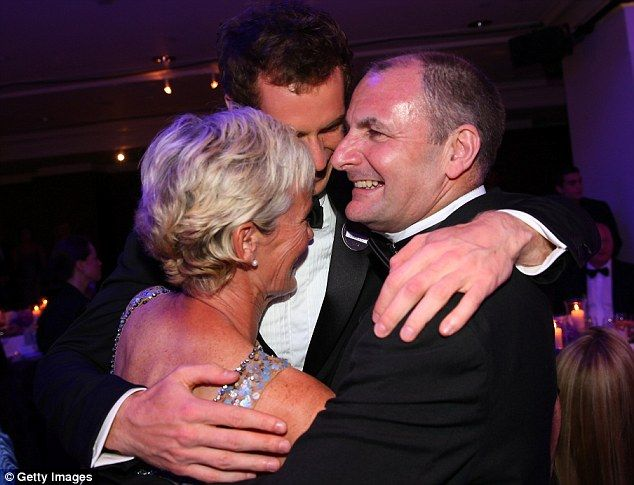 Proud parents: Andy Murray (C) hugs his parents Judy Murray and William Murray during the Wimbledon Championships 2013 Winners Ball at InterContinental Park Lane Hotel