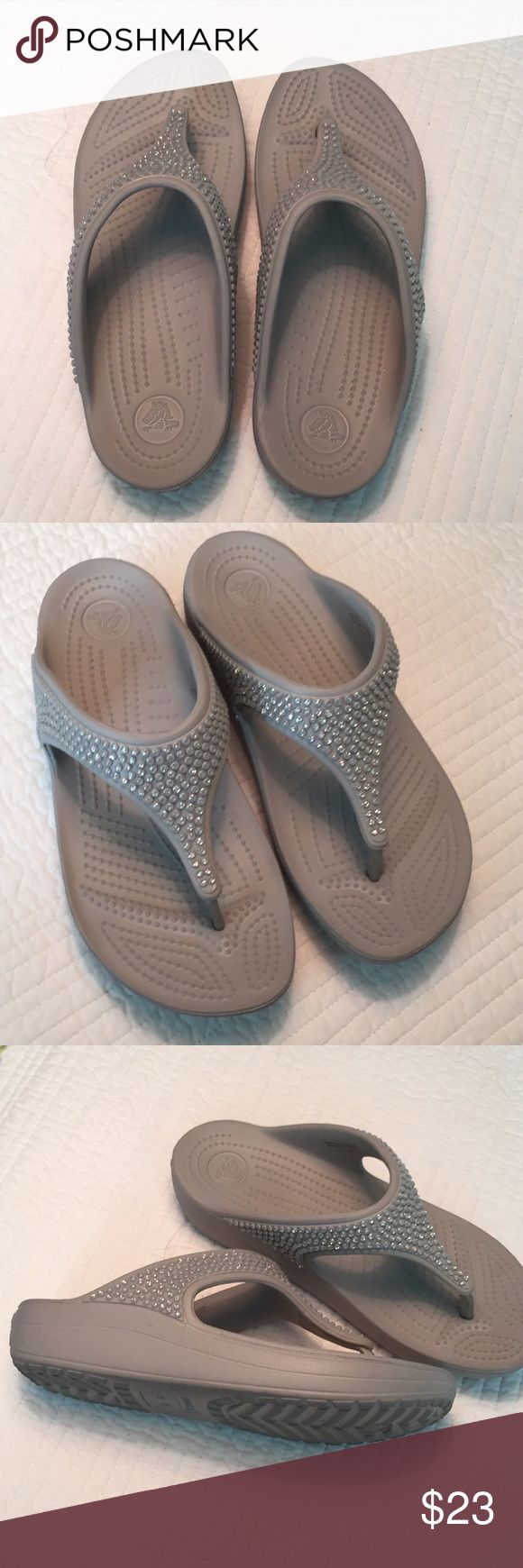 Crocs 7 gray bling flip flops Light walking wear but maybe a handful of Times. Thank you for looking. Smoke free home. CROCS Shoes Sandals
