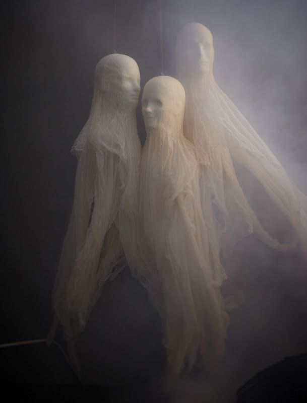 Foam heads and cheesecloth make for creepy Halloween ghosts