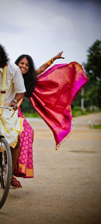 bride and groom on bike. Tamil wedding