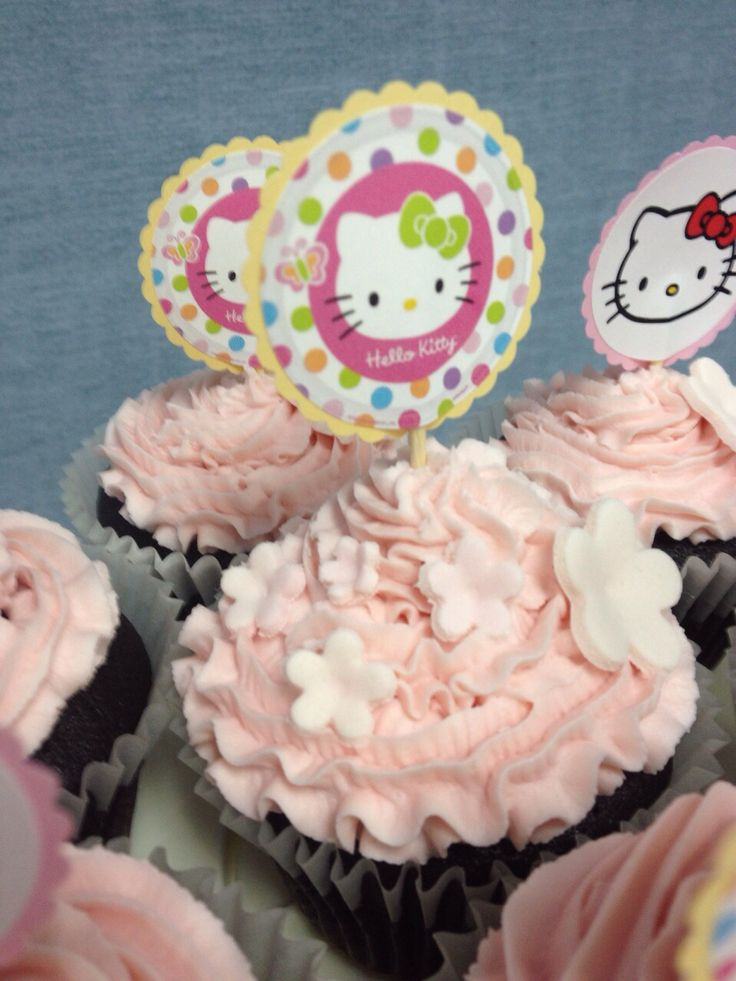 Hello Kitty themed cupcakes - moist chocolate cake with pink buttercream icing swirls, topped with dainty fondant flower blossoms and assorted Hello Kitty toppers.