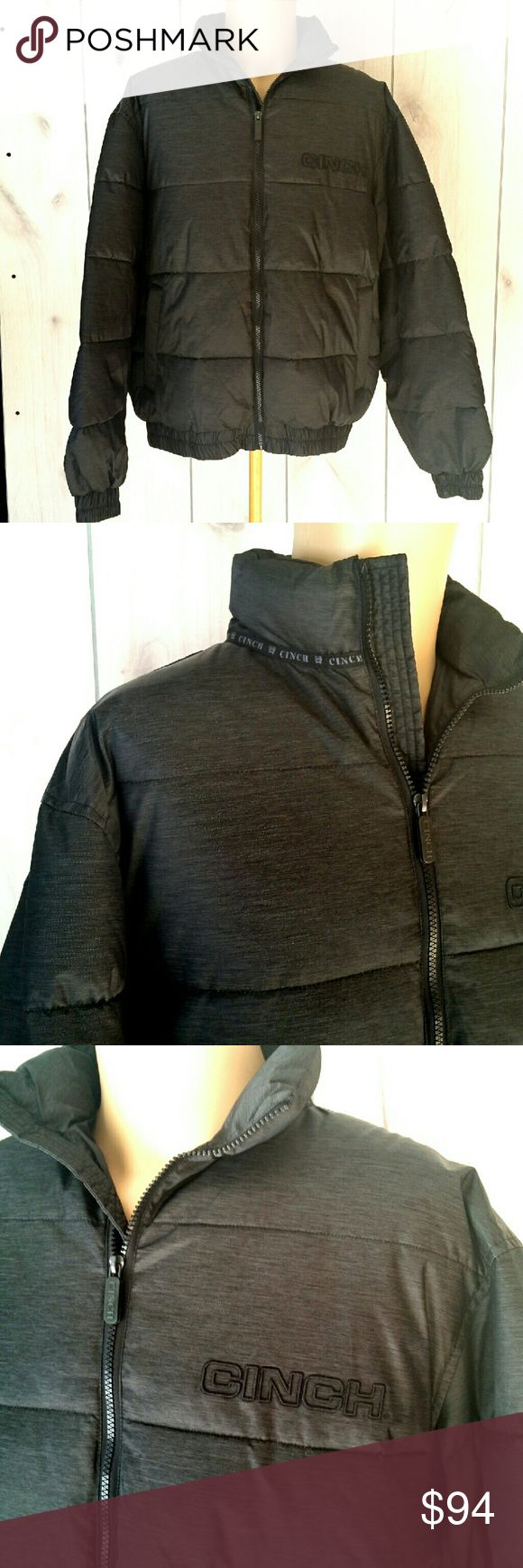 """Mens Puffer Coat by Cinch Black NEW with tag sz M Puffer Coat for men. By Cinch Jean Co. Two zippered hand warmer pockets. No inside pockets. Elastic cuffs and waist. Polyester fill. Not feather down. Outer material is a poly nylon blend. Chest measurement lying flat from armpit to armpit is 25"""". Length from top of shoulder to bottom is 26"""". Sleeve from collar to end of cuff is 32"""". Brand new with tags, retails for $200. Cinch Jackets & Coats Puffers"""
