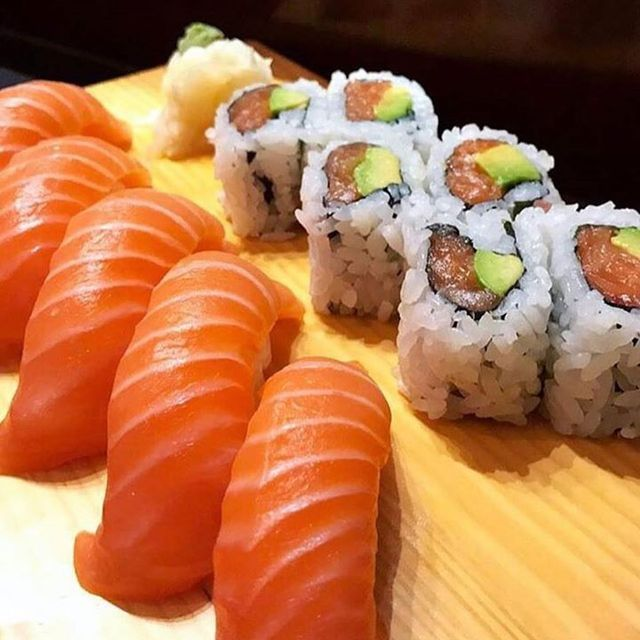 Salmon sushi rolls and salmon nigiri sushi