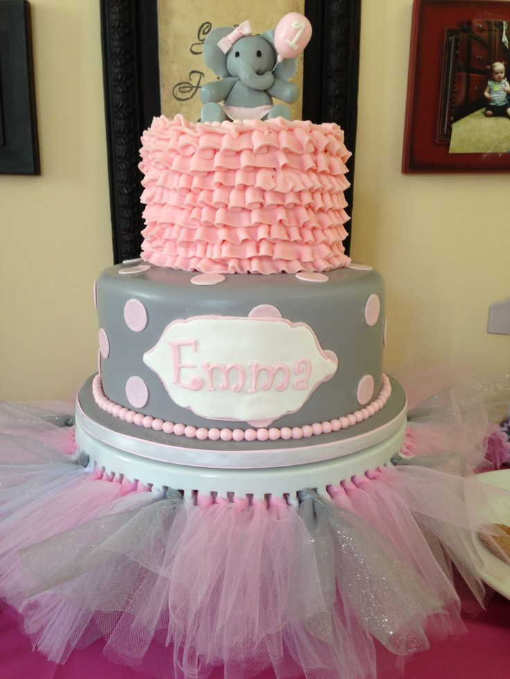 Emma's elephant birthday cake Cake made by DessertsbyDawn  Cake plate is a ribbon cake plate purchased at Home Goods then I used tulle from her tutu to go through each slot where the ribbon was laced.