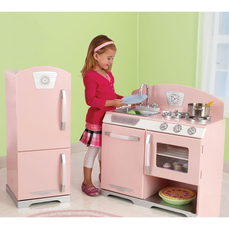 Provide your child with hours of make-believe play with this durable KidKraft retro kitchen and refrigerator. The dishwasher, oven, and sink feature movable knobs for added realism, and the kitchen has a removable sink, which makes cleanup easy.