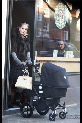 Arsenal striker Nicklas Bendtner and Baroness Caroline Luel-Brockdorff and their new baby boy. That's simply the way to look cool on the go... #Bugaboo