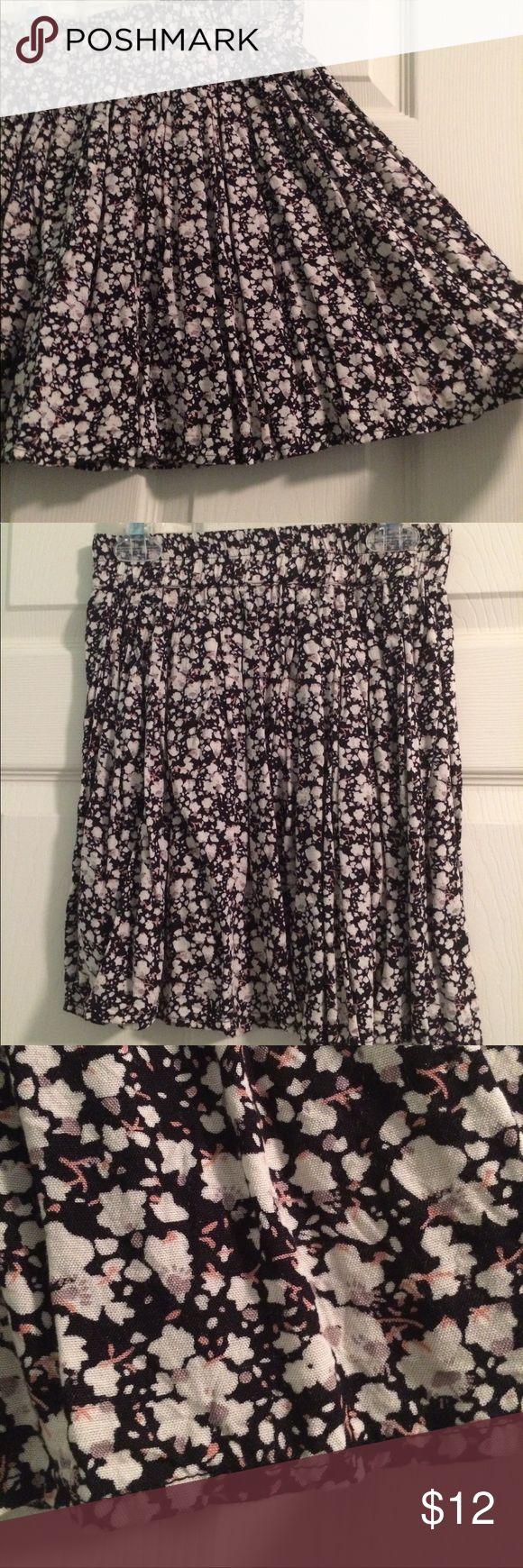 Delia's Floral Skater Skirt, Small, Black & Beige A floral skater skirt from Delia's in a size small. 100% cotton. Good condition, only worn a couple of times until I unfortunately outgrew it! I paired it with black pantyhose and black heeled booties. Delia's Skirts Circle & Skater