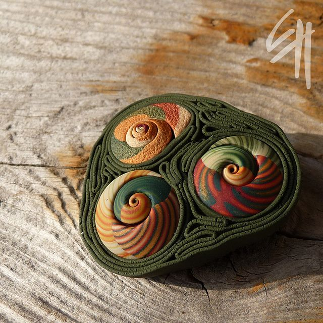 Eva Haskova, soutache-style brooch made with clay ribbons and spiral beads