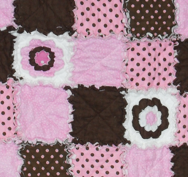 up close image of Brown and Pink Flower rag quilt