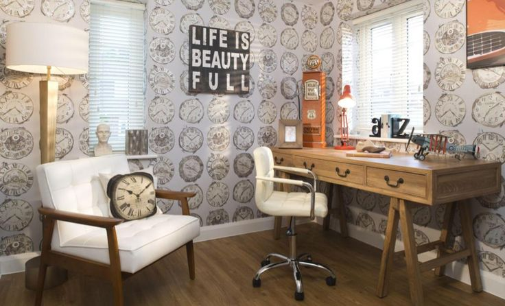 Interior Designed Modern Study using an industrial / steampunk wallpaper of old clocks and orange accents. There's a hint of 1950s America in this scheme.