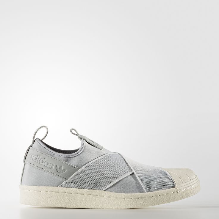 The classic adidas Superstar sneaker gets remixed as a chic slip-on. These women's shoes feature a flexible jersey upper that's adorned with stretchy bands that crisscross at the top of the foot. Detailed with suede and lined with textured twill. The rubber shell toe stays true to the original style.