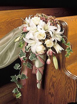 How to make cone pew/chair markers for a wedding to reserve pew/chair for family. Silk or Real flowers, could also put the initial of the Groom on the cone.