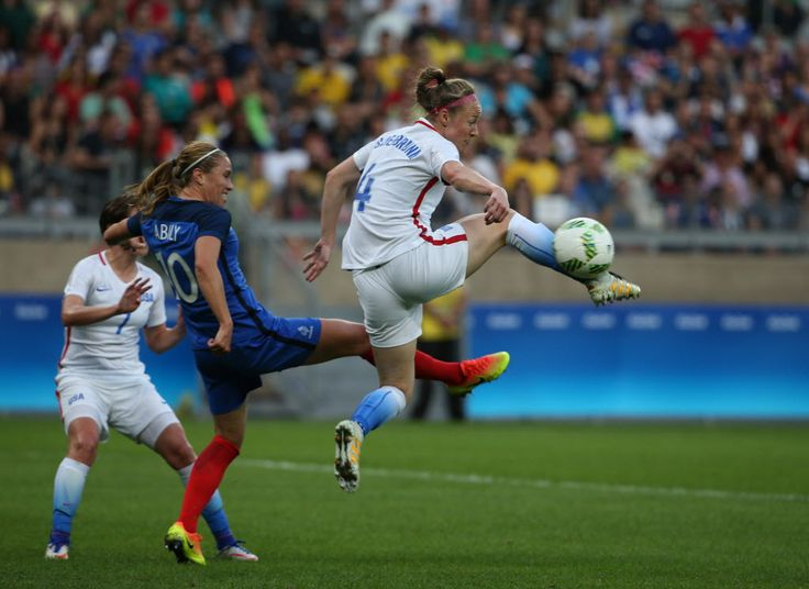 Becky Sauerbrunn and Camille Abily of France, Aug. 6, 2016. (Eugenio Savio/AP)