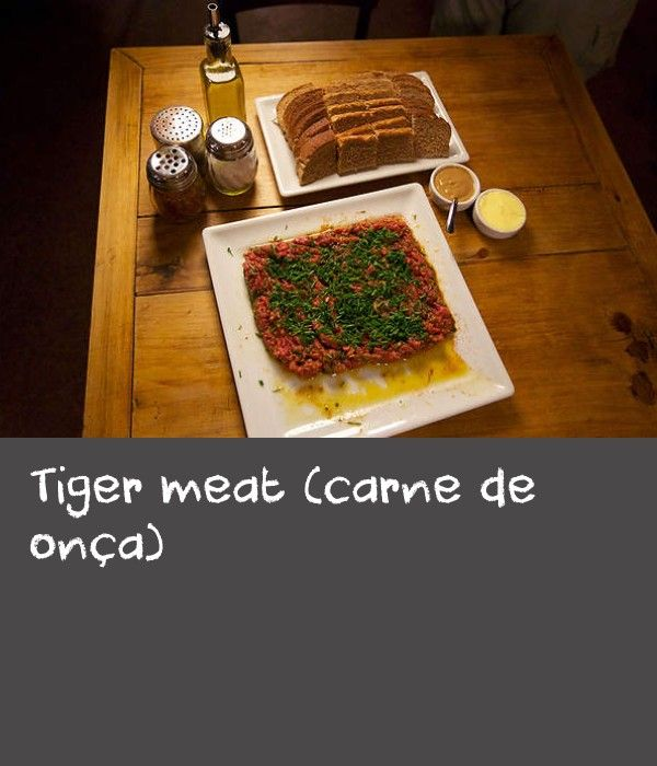 Tiger meat (carne de onça) | Carne de onça, a type of beef tartare, has been served in the Mercearia Fantinato in Curitiba since 1953 and it is popular in restaurants all over town, so much so that it has been embraced as Curitiba's official dish. The recipe is named after a native Brazilian cat known as an onça (jaguar), and it's said that eating the dish will give you the breath of the onça due to its pungent ingredients. Waiters at the restaurant joke that if a couple is on a date, they…