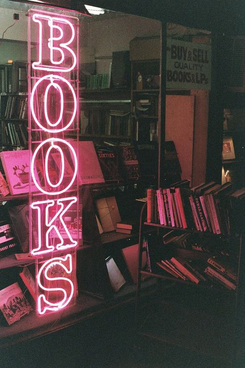 """Neon Pink """"BOOKS"""" Sign In Bookstore Window Photo via SpookyPoolParty.Tumblr.Com --- I would love to have signage like this to decorate my home library with!!"""