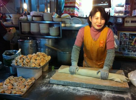 Rolling dough to make kalguksu (칼국수 - knife-cut noodles), at Gwangjang Market in Seoul