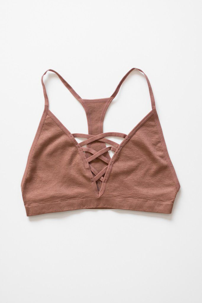A simple bralette with the criss cross strappy detailing in front and a racerback. Wear it underneath loose-fittingshirts, or even as a yoga top. Made with lig