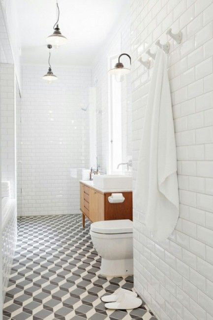 patterned cement tile, beveled tile to ceiling. Like the ceramic hooks and funky lights