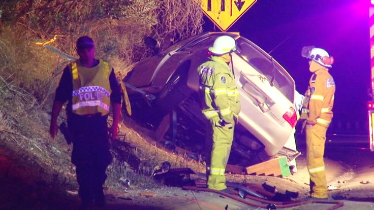A woman is dead and a man fighting for life in hospital after a head-on collision west of Sydney last night.