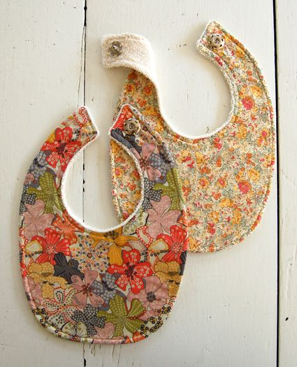 Great tutorial on making cutesy diy baby bibs - you can even buy the fabric from her site...or use your own!