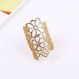 Carved flower ring with opening and mysterious blonde