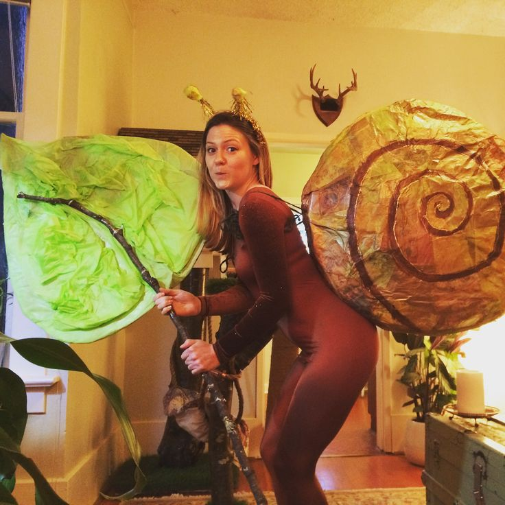 My snail costume - shell made of two hula hoops, cardboard and packing paper. Modge-podged tissue for beautification!