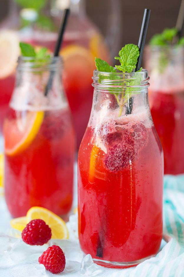 31 Clever Ways To Serve Drinks In Jars - Sparkling Raspberry Lemonade - Fun and Creative Way to Serve Soda, Tea, Cocktails and Party Drinks. Mason Jar Recipes and More Easy, Fun Ideas http://diyjoy.com/cool-ways-to-serve-drinks
