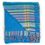 Sea Blue towelling with beautiful cotton 'kikoy' backing of rainbow striped blues and greens.
