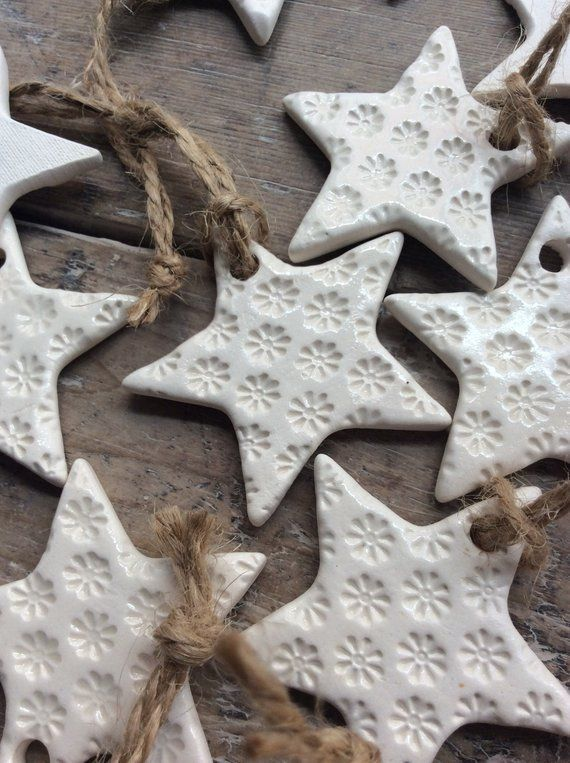 Handmade ceramic white star ornament with daisy design. Christmas Gift Tags, Decorations, Wedding,