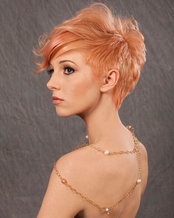 "I love this longer in the front pixie hair cut. But, what I really love is the orange-ish, peach blonde shade that almost resembles that orange-peach of a ""cheap"" foundation."