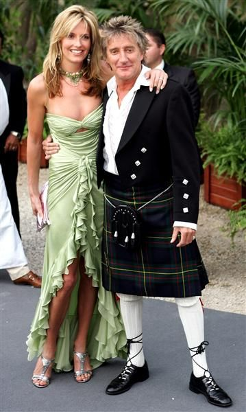 Rod Stewart wears a kilt as he arrives with Penny Lancaster for the amfAR Cinema against AIDS event at the Moulin de Mougins restaurant near Cannes, France, on May 20, 2004.