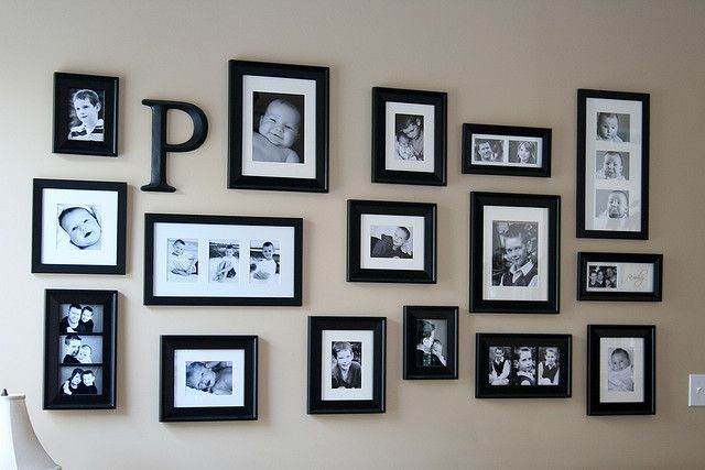 Going for this type of look for my photo wall in the dining room.  I have most of the frames on the wall but not all have photos in them yet lol!