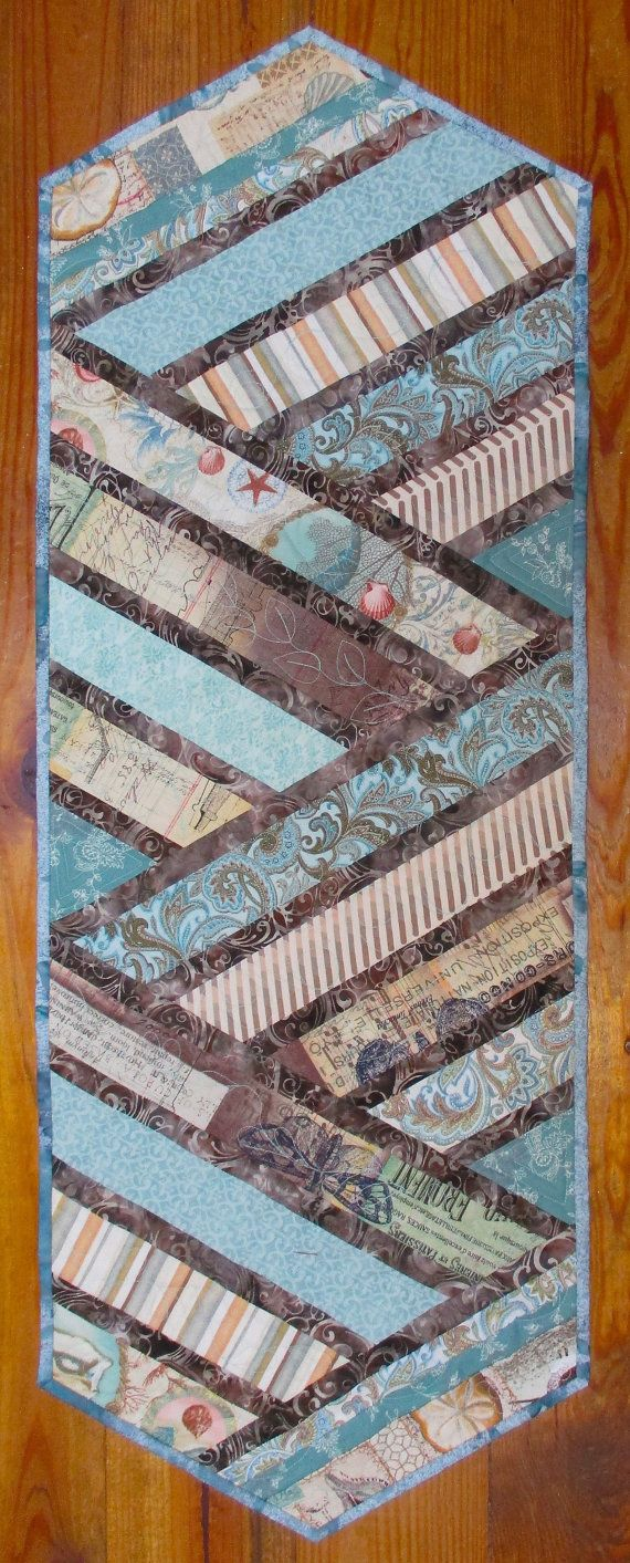 This beach theme quilted table runner is pieced cotton fabrics with a dark brown batik accent and batik double fold binding. Shell prints, blues and sand beige colors. The perfect addition to you beach cottage, coastal decor kitchen table or a dining room side table. The back is a pretty turquoise print. Quilted on my home machine. This table runner measures approximately 15 x 40. See my other table runners: https://www.etsy.com/shop/paintedquilts?section_id=14363934&...