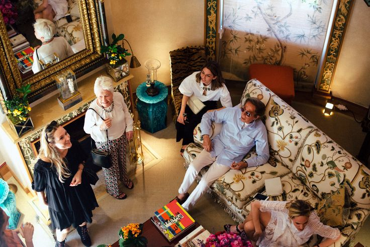 A party at the designer's French chateau celebrates the director's Cannes award.