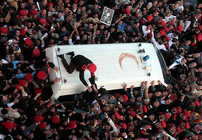 24 hours in pictures: Police restrain mourners surrounding ambulance carrying Pope Shenouda III